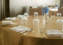 Tables set for dinner. In hotel Stock Photos