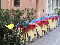 Tables set for dinner. In the alley of the historic city center Royalty Free Stock Photography