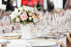 Tables set for an event party or wedding reception. luxury elegant table setting dinner in a restaurant. glasses and. Dishes Royalty Free Stock Image