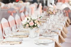 Tables set for an event party or wedding reception. luxury elegant table setting dinner in a restaurant. glasses and. Dishes Stock Image