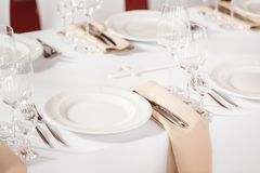 Tables set for an event party or wedding reception. luxury elegant table setting dinner in a restaurant. glasses and. Dishes Royalty Free Stock Photo
