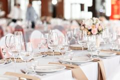 Tables set for an event party or wedding reception. luxury elegant table setting dinner in a restaurant. glasses and. Dishes Stock Photos