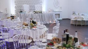 Tables set for an event party or wedding reception. luxury elegant table setting dinner in a restaurant. glasses and stock footage