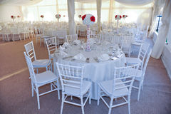 Tables set for an event party or wedding reception. Wedding tables setting in white color. Tables set for an event party or wedding reception. Elegant table Royalty Free Stock Photos