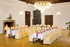 Tables set for a festive dinner. Interior of a manor house Royalty Free Stock Image