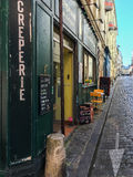 Tables set for lunch at creperie on a Paris street Royalty Free Stock Images