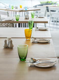 Tables set for meal. In modern dining room interior Stock Photos