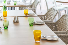 Tables set for meal. On wooden table Royalty Free Stock Photos