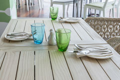 Tables set for meal. On wooden table Royalty Free Stock Photo