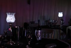 The tables at Silver Wedding Party. Silver Wedding Anniversary Party. The tables, the social, bottles, glasses and the ambient table lamps of glass royalty free stock photo