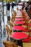 Tables of a street cafe in Paris at rain Stock Photo
