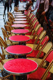 Tables of a street cafe in Paris at rain Royalty Free Stock Image