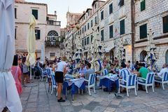 Tables of a street restaurant in the old town of Dubrovnik. Stock Images