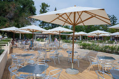 Tables and tents in the summer restaurant. MOSCOW - AUGUST 2: Tables and tents in the summer restaurant at VDNKh in Moscow on August 2, 2014. VDNKh (called also stock image