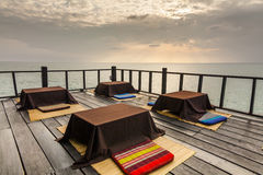 Tables on the terrace of the coastal cafes. Koh Chang. Royalty Free Stock Photos
