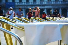 Tables and tourism in St. Mark's Square, Venice Stock Photo