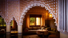 Tables in traditional Arabian illuminated interior stock images