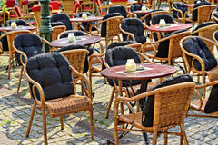 Tables of traditional outdoors cafe in European city Stock Image