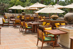 Tables with umbrellas in tropics Royalty Free Stock Photos