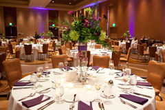 Tables at wedding reception. Bouquets of flowers on laid tables at wedding reception Royalty Free Stock Images