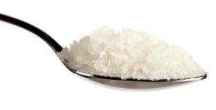 Tablespoon of coarse sea salt against white Stock Photo