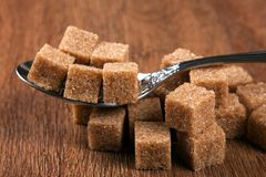 Tablespoon with cubes of brown sugar Royalty Free Stock Photos
