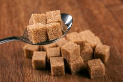 Tablespoon with cubes of brown sugar Royalty Free Stock Image
