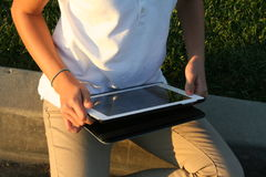 Tablet. Person holding a tablet in front of themselves Royalty Free Stock Image
