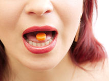 Tablet. Orange Tablet in a mouth Stock Photo