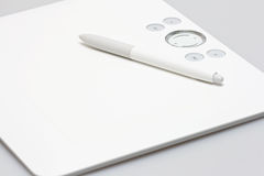 Tablet. With pen on gray Stock Photos