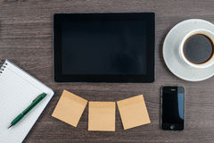 Tablet, Adhesive Note, notebook and smart phone with coffee Royalty Free Stock Image
