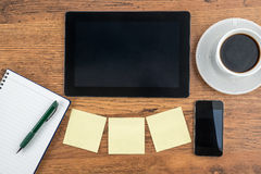 Tablet, Adhesive Note, notebook and smart phone with coffee Royalty Free Stock Photo