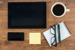 Tablet, Adhesive Note, notebook and smart phone with coffee Stock Images