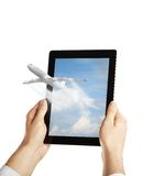 Tablet with airplane Royalty Free Stock Photos