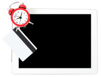Tablet with alarm clock and credits Stock Image