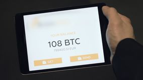 Tablet application showing the balance of a Bitcoin wallet. Stock. Digital currency concept. Balance of bitcoins on the stock photos