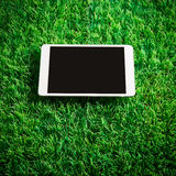 Tablet on artificial grass Stock Image