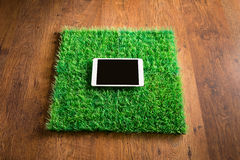 Tablet on artificial grass tile Stock Photography
