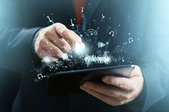 Tablet as Music Player Stock Image