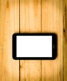 Tablet auf hölzernem Hintergrund im warmen Ton Lizenzfreie Stockbilder