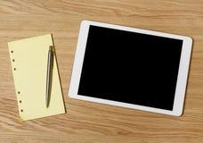 Tablet auf Schreibtisch Stockfotos