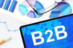 Tablet with b2b  Business to Business, graphs and glasses. Royalty Free Stock Photos
