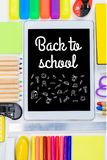 Tablet with back to school lettering. Flat lay with tablet and various school supplies, back to school concept royalty free stock photos