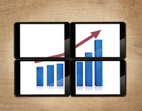 Tablet with bar chart. Bar chart show in four tablets Stock Photos