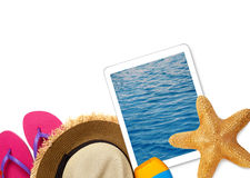 Tablet and beach accessories Royalty Free Stock Image