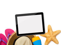 Tablet and beach accessories Royalty Free Stock Photo