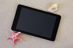 Tablet on the beach Royalty Free Stock Photography