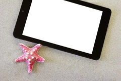 Tablet on the beach Royalty Free Stock Photo