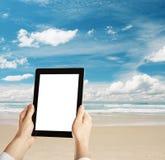 Tablet on beach Stock Photography