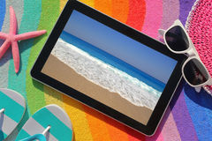 Tablet on beach towel Stock Photo
